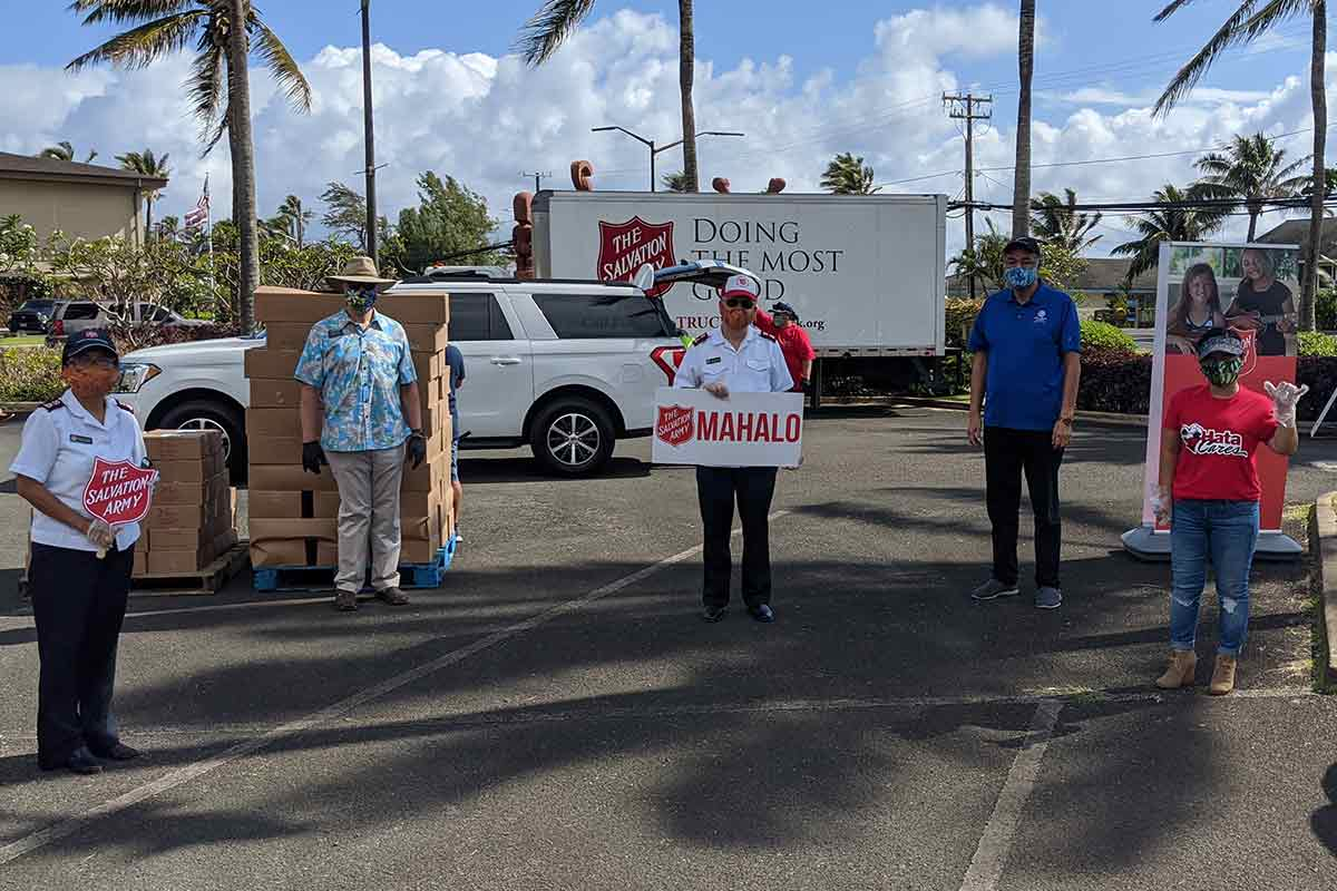 salvation army latter day saints and y hata representatives at COVID-19 relief food distribution