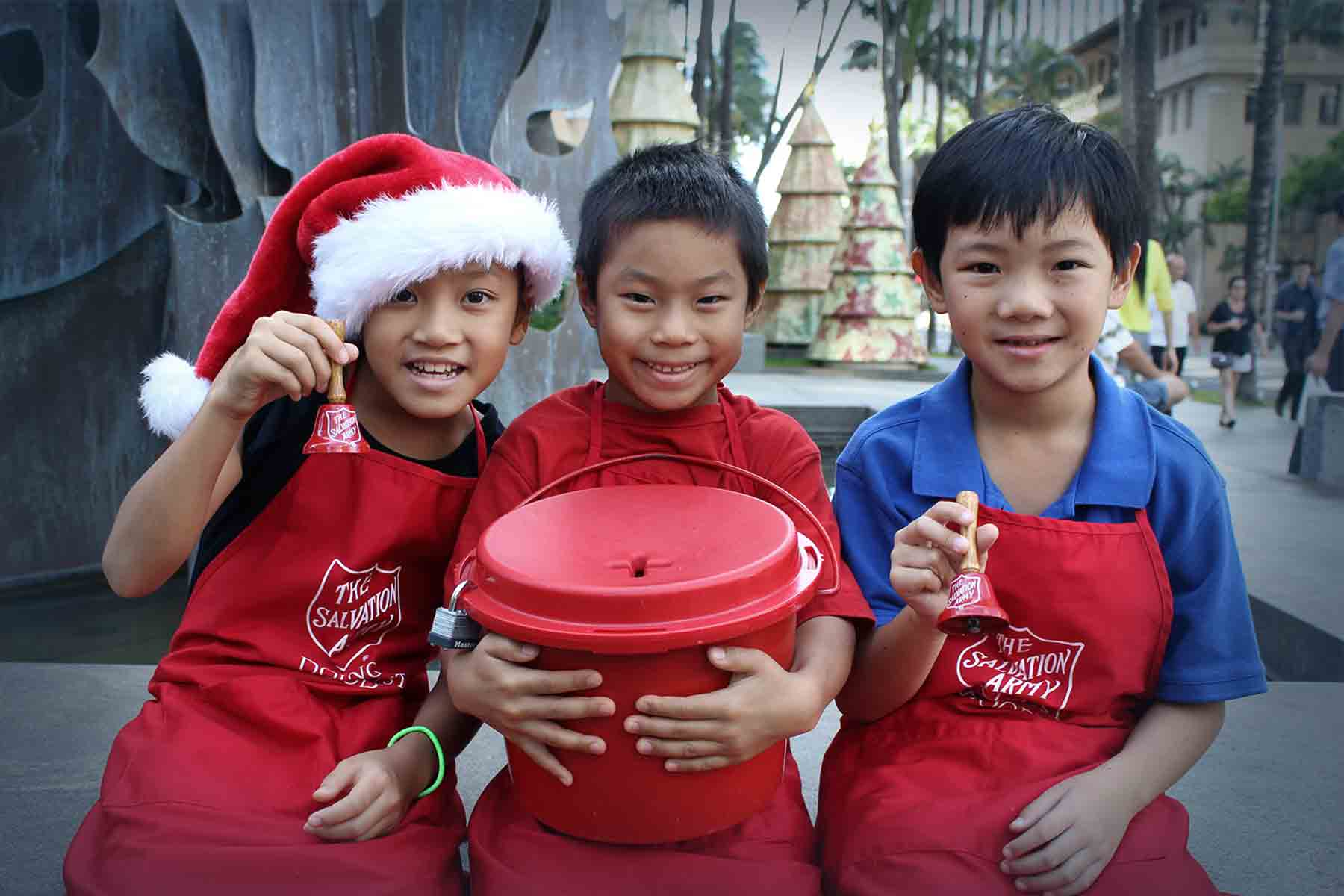 kids ringing salvation army bells