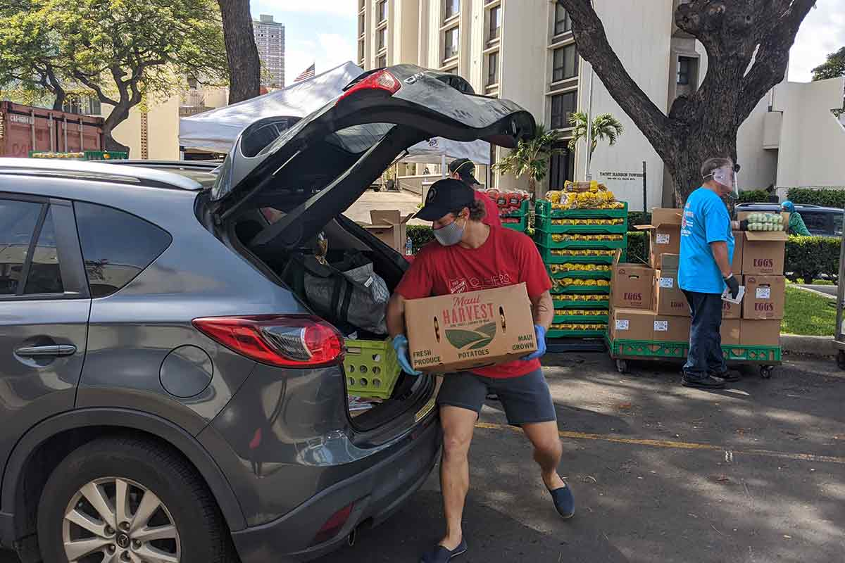 loading potatoes into car at food distribution