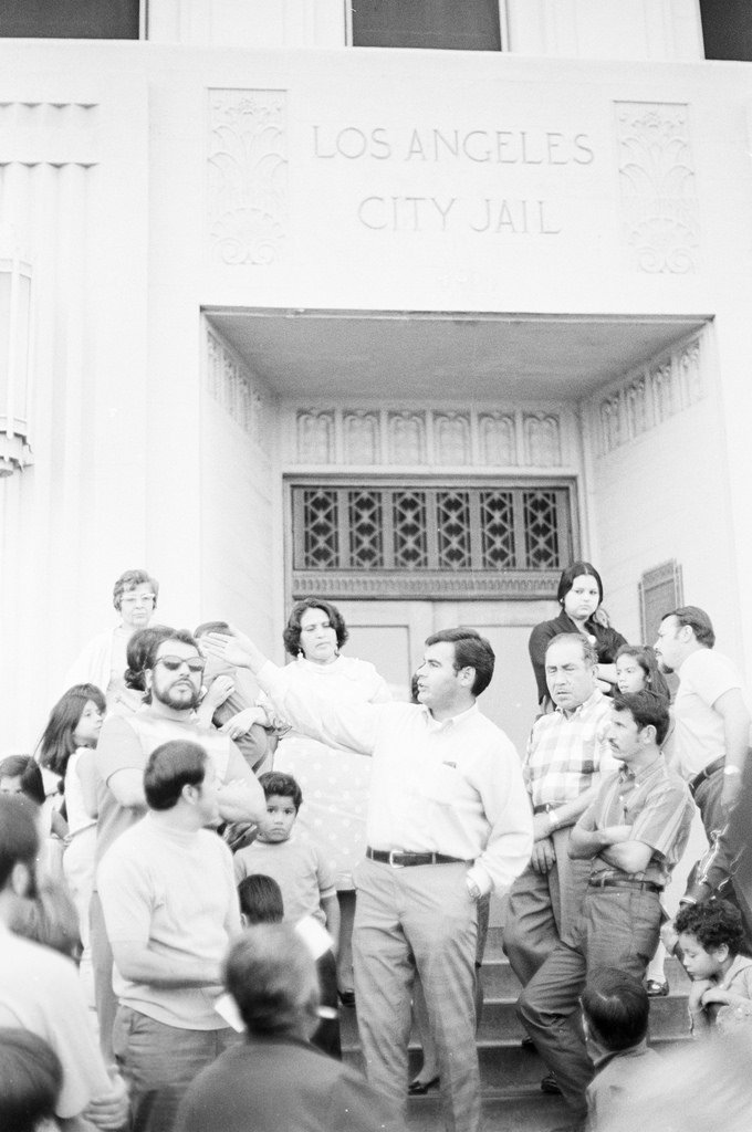 From left to right, Ed Bonnilla, Sal Castro, Esteban Torres, and other families waiting for Chicano activists to be released for the Los Angeles City Jail.