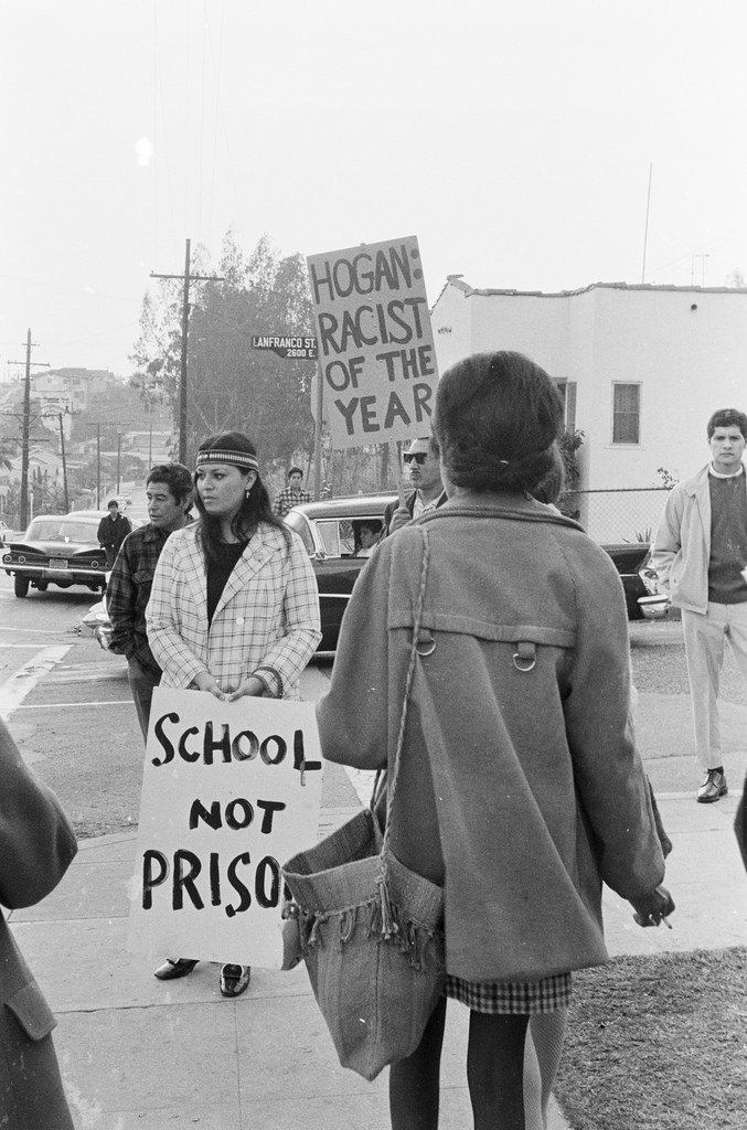 Hogan (referenced in one of the signs in this photo) was the Roosevelt High School Principal.