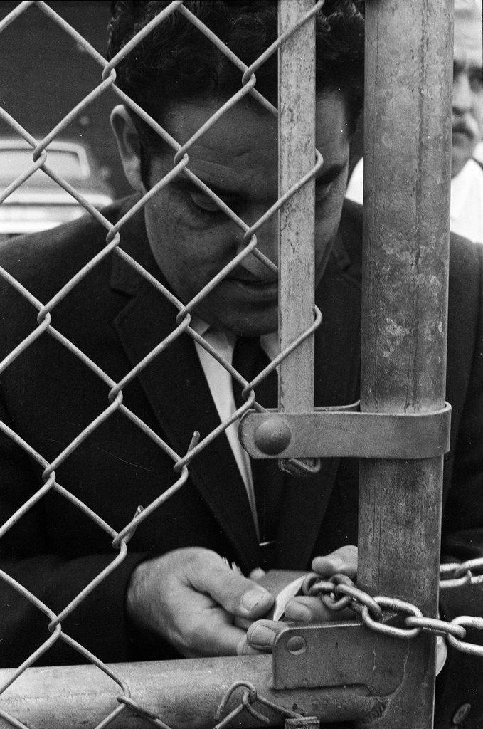 Art Velarde locking the gate at Roosevelt High School.