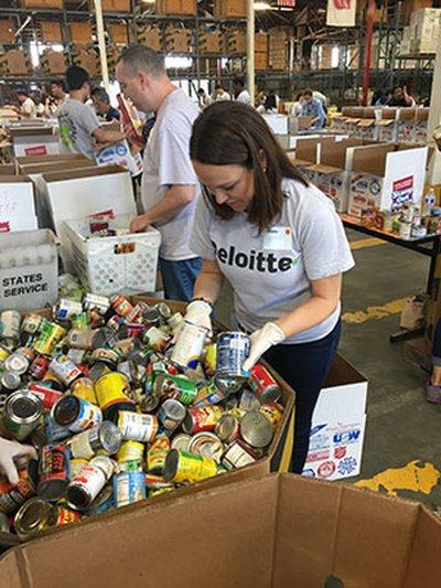 volunteer sarah sorting food
