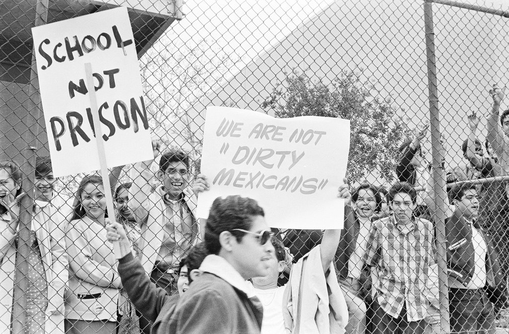 Students holding walkout signs