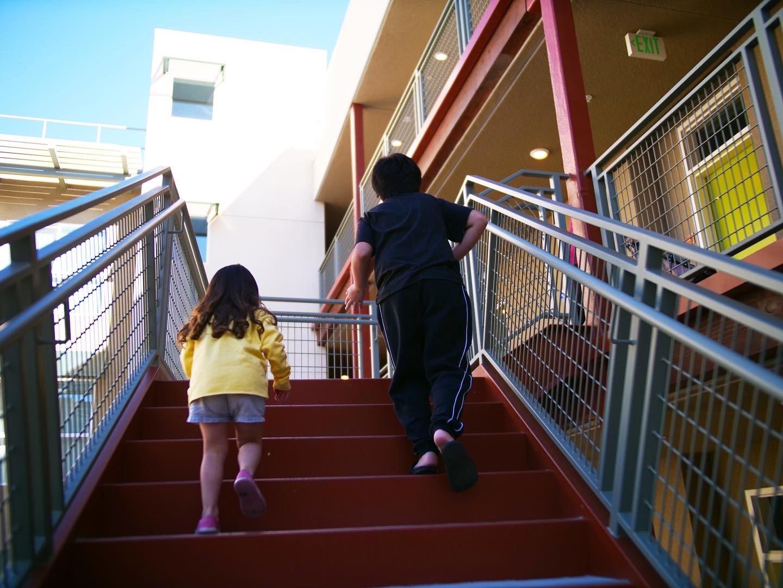 Child Running up stairs HHH Housing