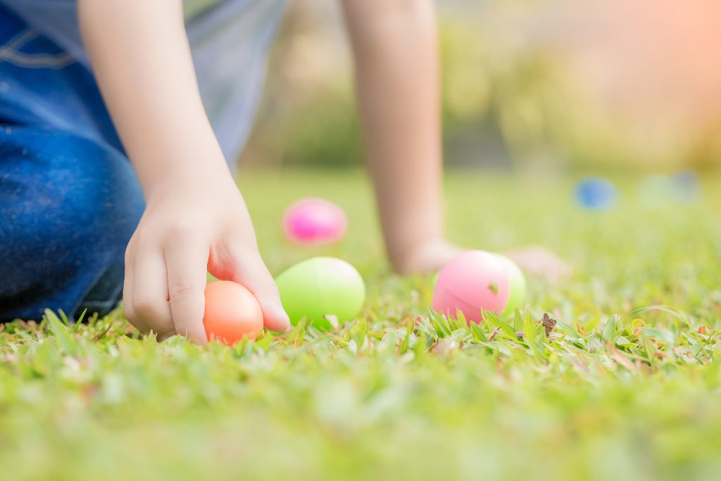 Child on easter egg hunt.