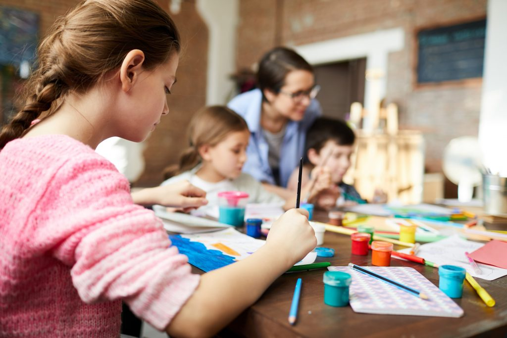 A child participating in art therapy activities for autism.