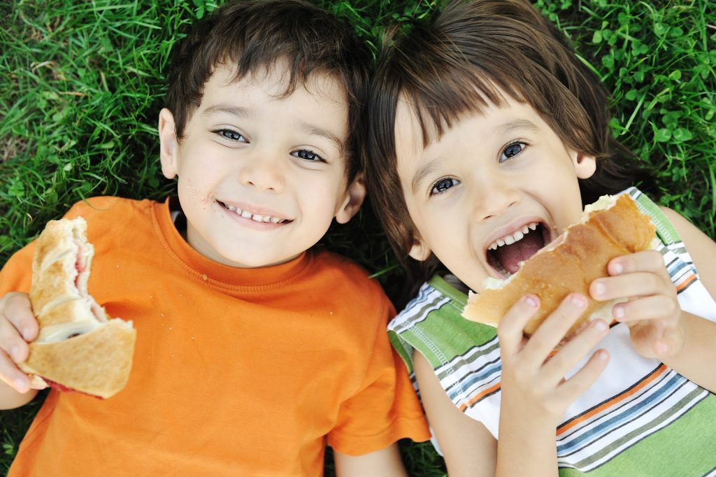 Kids with autism eating healthy snacks.