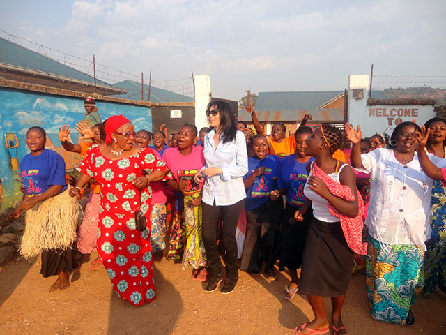 Yasmin Benguigui dances with residents at City of Joy.