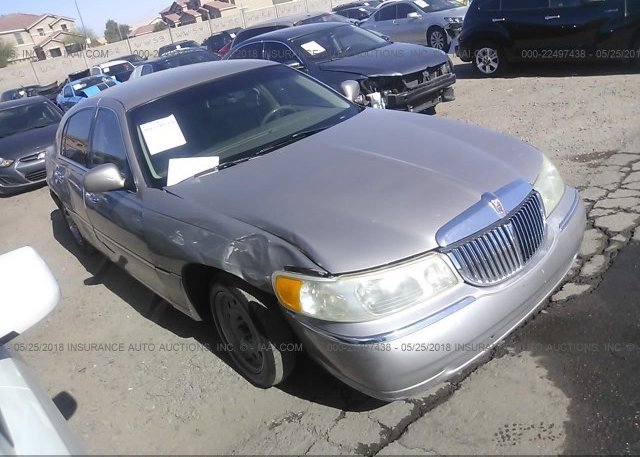 1lnhm81w94y606294 Salvage Silver Lincoln Town Car At Indianapolis