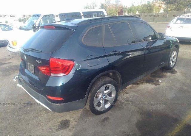 цена в сша 2014 BMW X1 WBAVM1C51EVW49014