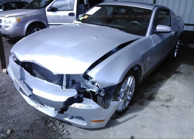 1ZVBP8AM9C5230029, Salvage silver Ford Mustang at TULSA, OK