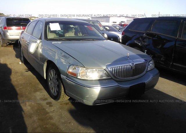 1lnhm82v27y617969 Salvage Title Light Blue Lincoln Town Car At