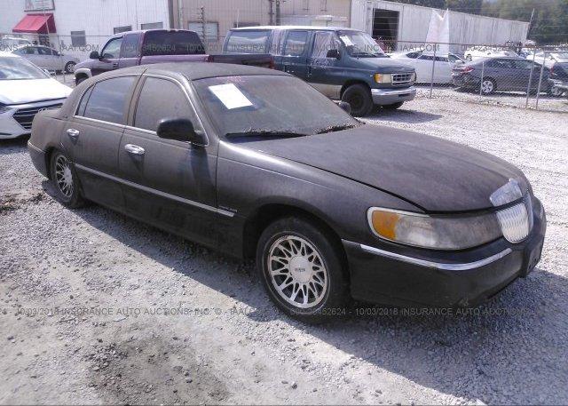 1lnlm82w1ry743939 Salvage Light Blue Lincoln Town Car At Phoenix