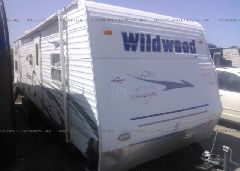 2009 WILDWOOD 32'WDT31QBSSLE - 4X4TWDG229A242963 Left View