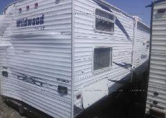 2009 WILDWOOD 32'WDT31QBSSLE - 4X4TWDG229A242963 rear view