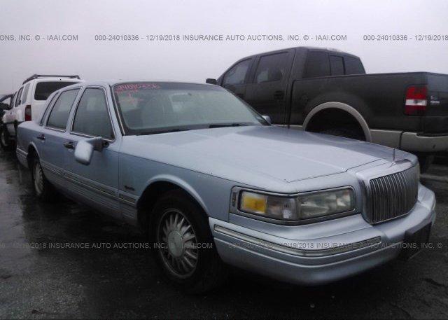 1lnhm82w11y717299 Clear White Lincoln Town Car At Ashland Va On