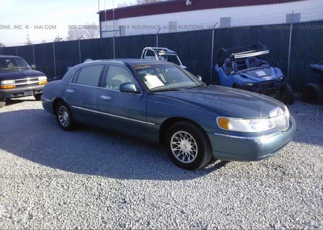 1lnhm82w2xy612618 Salvage Light Blue Lincoln Town Car At Pittston