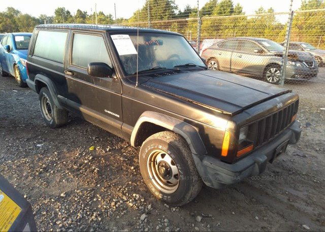 1J4FT27S0XL638935, Clear black Jeep Cherokee at TURNERSVILLE