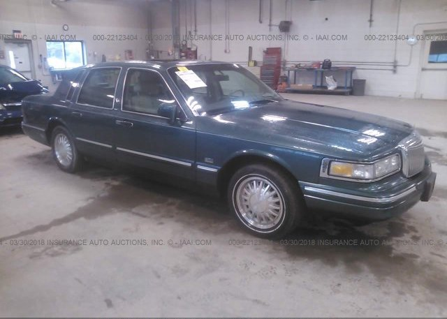 1lnhm81wx4y609267 Salvage Green Lincoln Town Car At Moss Point Ms