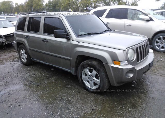 1j8ff28w37d347217 Clear Gold Jeep Patriot At Springfield Ne On