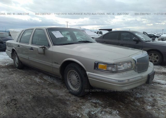 1lnlm82w4vy758980 Clear Gold Lincoln Town Car At Missoula Mt On