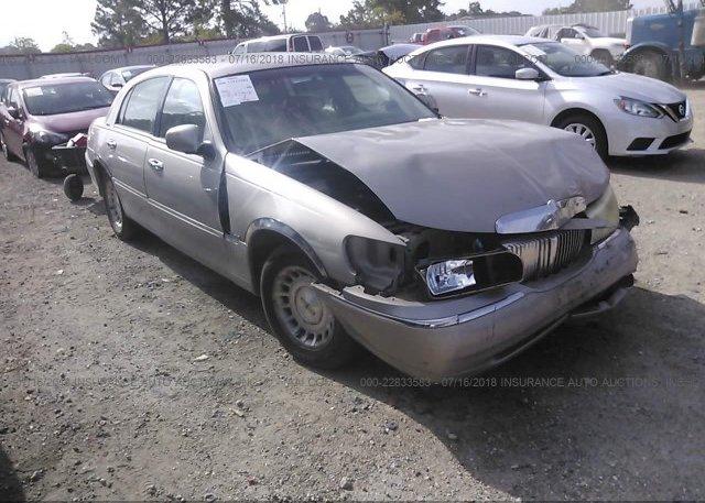 1lnhm81w4xy684910 Salvage Gold Lincoln Town Car At Lafayette La On