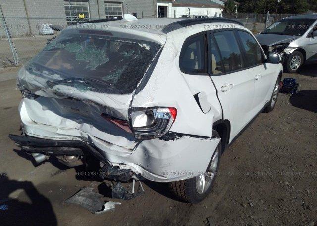 цена в сша 2015 BMW X1 WBAVL1C55FVY26183
