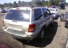 1999 JEEP GRAND CHEROKEE - 1J4GW68N2XC598871 rear view