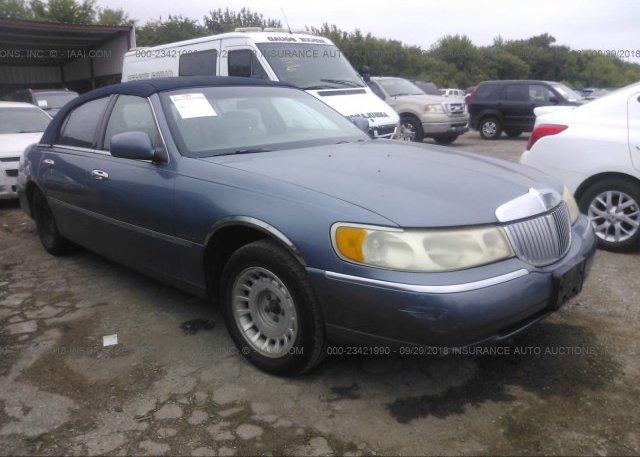 1lnhm81w9yy856544 Clear Blue Lincoln Town Car At Grand Prairie Tx
