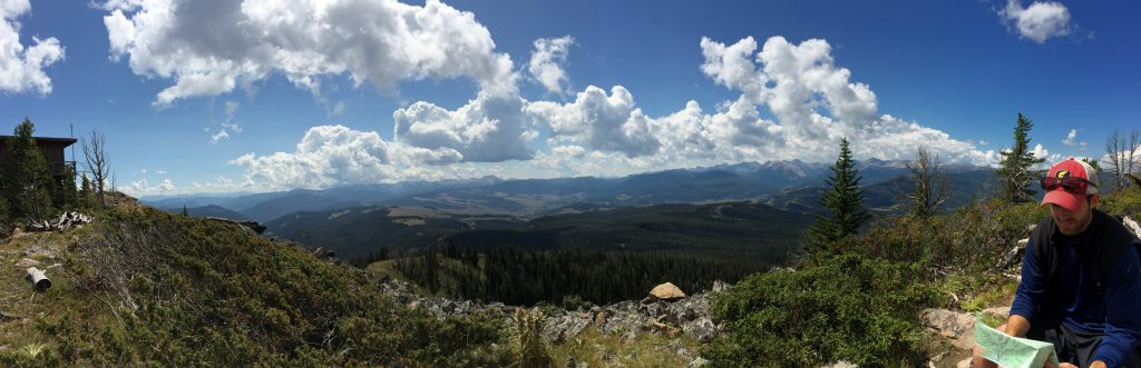 Hiker Looking at Map | Visit Big Sky