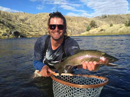Chase Navratil with a Rainbow Trout | Photo: Alex Mansfield