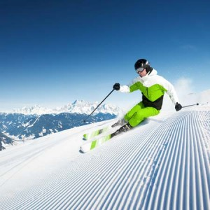 dynamic skiing on groomed run | Shutterstock