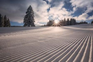 sun rise over groomed slope | Shutterstock