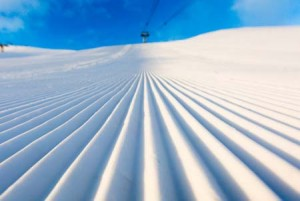 groomed ski run under chairlift | Shutterstock