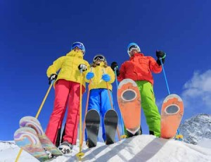 three skiers under bluebird skies | shutterstock