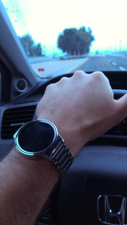 Huawei Watch on wrist while driving