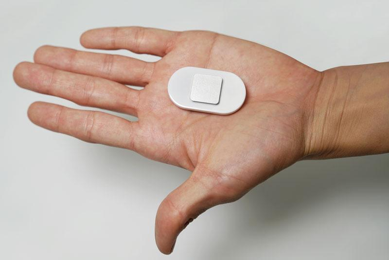 Lumo Lift in palm of hand