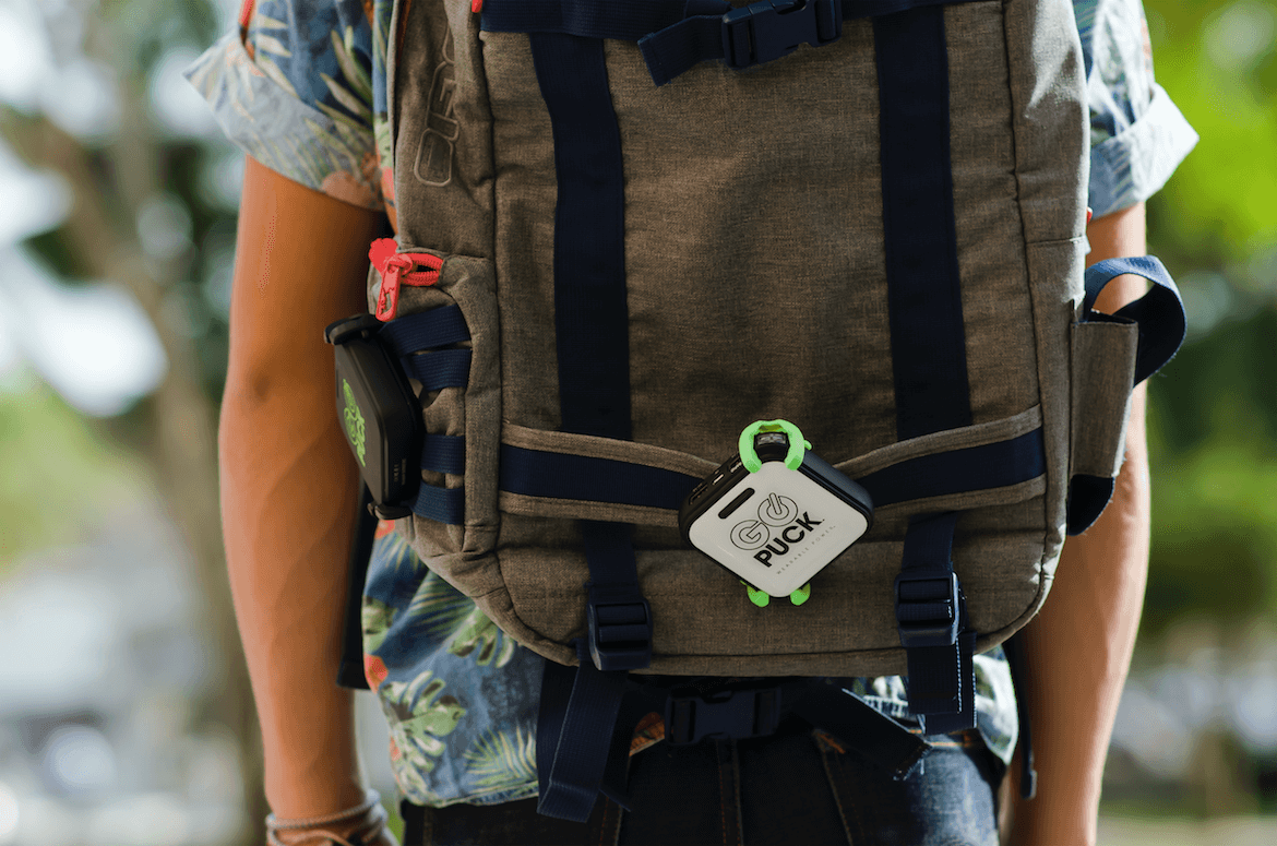Go Puck portable charger on backpack