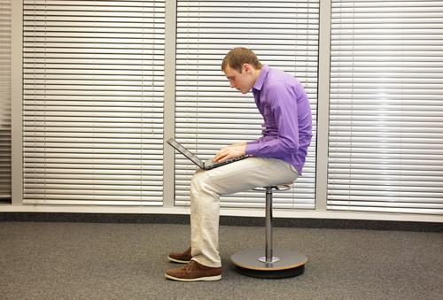 Man slouching at desk