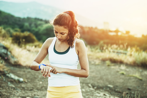 Woman stopping to view fitness tracker