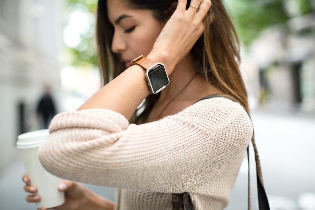 Woman wearing Fitbit Blaze