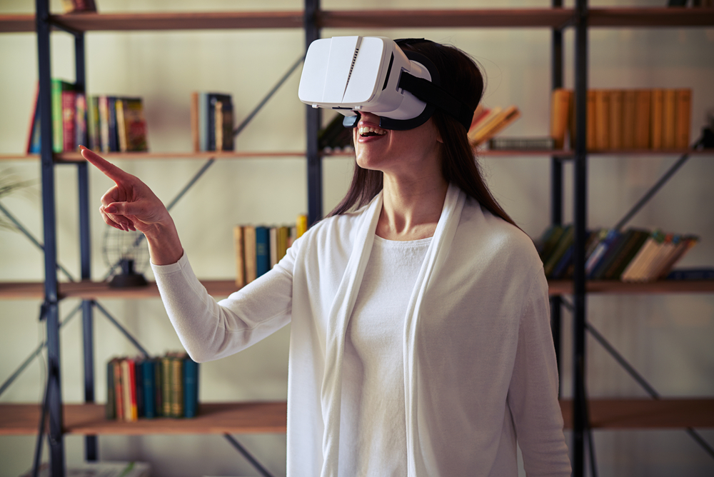 VR news: Woman looking through VR headset