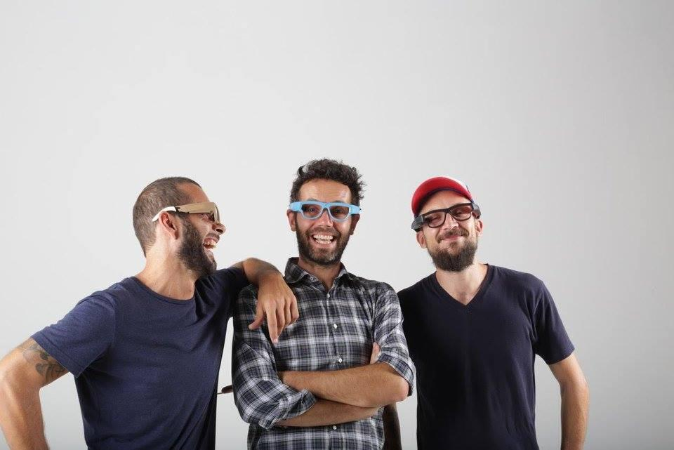 Three guys wearing GlassUp smart glasses