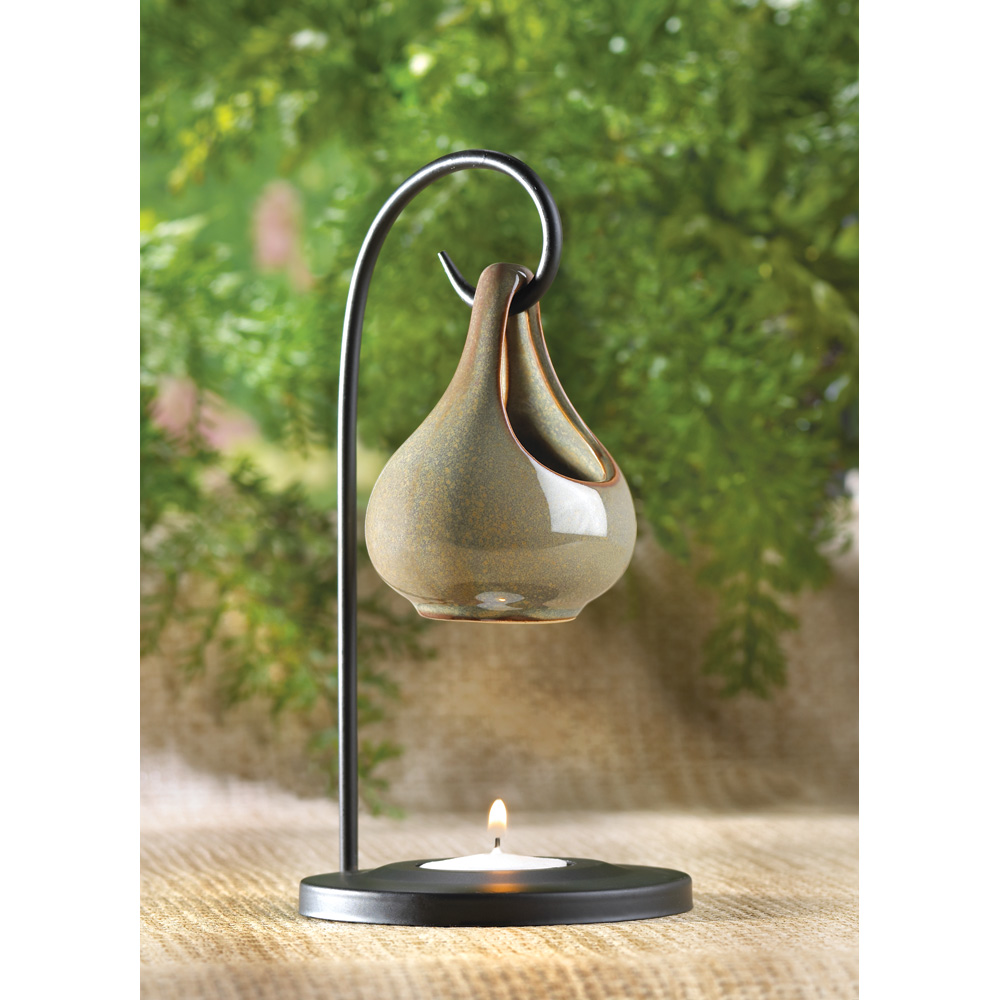 CANDLE WARMER: Candle Warmers allow all the fragrance of a candle with no flame. A candle warmer can be left on 24/7 for all the benefits of the candle & warmer. The inside diameter of each candle warmer is a little over 4 inches.