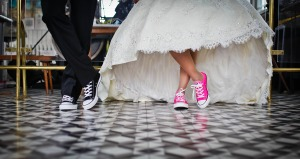 couple wearing matching sneakers at their wedding
