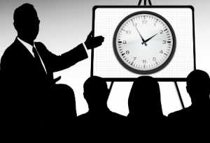 man in silhouette is the time keeper for his meeting