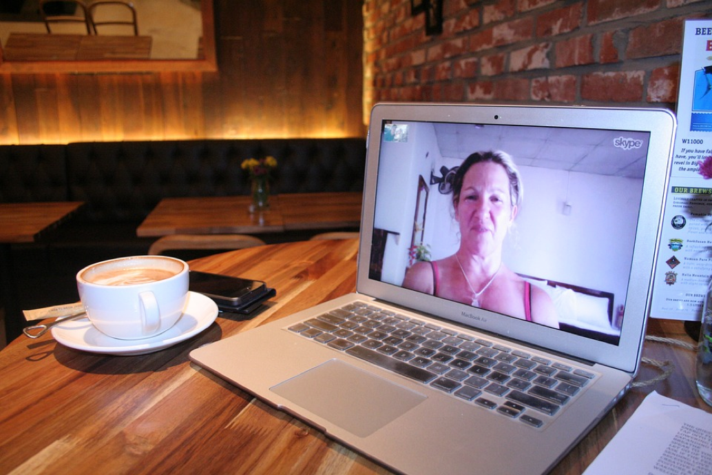 skype user on a web conference call with iOS apple macbook