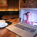 free screen sharing on apple iOS laptop on a table with coffee