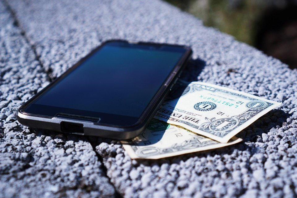apple ios iphone with dollar bills for non profit financial plan